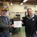 David Barnhill receiving the Employee of the Quarter (first quarter) recognition in April 2020 recognition from Nick Katers, Associate Vice Chancellor of Facilities Management.  Note the respectful distance required by the earliest COVID-19 protocols.